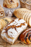 Breads and rolls on wooden table Royalty Free Stock Photos