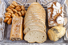 Breads and rolls on wooden table Stock Photography