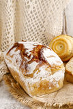Breads and rolls on wooden table Royalty Free Stock Photo