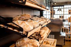 Breads on the shelves in the shop. Breads on the wooden shelves of the bakery shop Royalty Free Stock Image