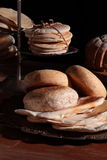 Breads on a table. Whole wheat bread pieces, pita, muffin bread, baguette and baked bread are on the table Royalty Free Stock Photos