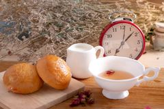 Breads and Tea on wooden table,Breakfast Morning Meal royalty free stock photo