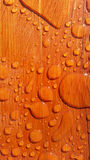 Breads of water on grain wood. High gloss Royalty Free Stock Photography