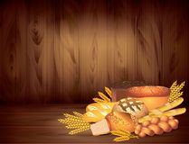 Breads and wheat on dark wooden background  Royalty Free Stock Photo