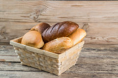 Breads and Wheat Ears on Board Royalty Free Stock Image