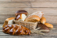 Breads and Wheat Ears on Board Stock Images