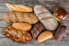Breads and Wheat Ears on Board Stock Image