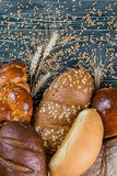 Breads and Wheat Ears on Board Stock Photos
