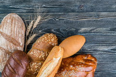 Breads and Wheat Ears on Board Royalty Free Stock Photos