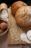 Breads on wooden plate. With eggs, flour and grains stock photos