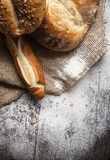 Breads on wooden table Stock Photos