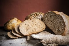 Breads on wooden table Stock Images