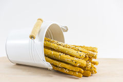 Breadstick golden brown  in  white tank on wood and white background.1. Breadstick golden brown  in  white tank on wood and white background.Snack or dessert Stock Photos