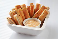 Breadsticks. Fresh breadsticks served with dip sauce Royalty Free Stock Photo