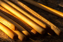 Breadsticks in afternoon sun Royalty Free Stock Photos