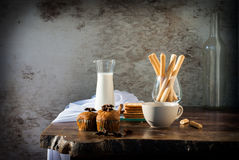 Breadsticks ,Banana cake, milk  and Biscuits with black coffee i Royalty Free Stock Photos