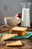 Breadsticks ,Banana cake, milk  and Biscuits with black coffee i Royalty Free Stock Images