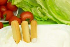 Breadsticks and cream cheese Stock Photo