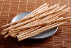 Breadsticks on dish Stock Image
