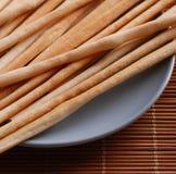 Breadsticks on dish Royalty Free Stock Image