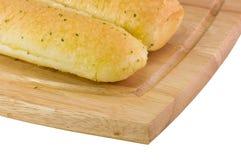 Breadsticks do alho no detalhe da placa de estaca Fotos de Stock Royalty Free