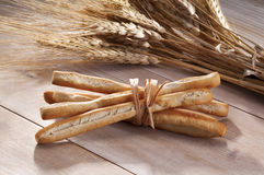 Breadsticks with ears of corn Royalty Free Stock Photos