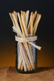 Breadsticks in Glass Jar Royalty Free Stock Photography