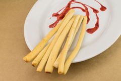 Breadsticks grissini with Strawberry Sauce. Breadsticks grissini with red Strawberry Sauce Stock Image