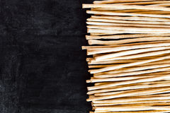 Breadsticks grissini torinesi on blackboard Royalty Free Stock Photography