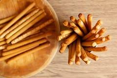 Breadsticks grissini on wooden background Stock Image