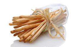 Breadsticks in Jar on its Side Tied with Raffia Stock Photos