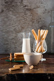Breadsticks ,milk and Biscuits with black coffee in the morning. Royalty Free Stock Image