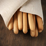 Breadsticks in napkin Royalty Free Stock Images