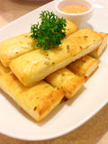 breadsticks with parsley and sauce Royalty Free Stock Images