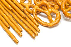 Breadsticks and salted pretzels. On white background closeup Stock Image