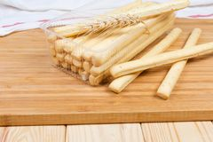 Breadsticks with sesame seeds and wheat ear close-up stock photography