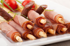 Breadsticks with smoked ham Royalty Free Stock Photography