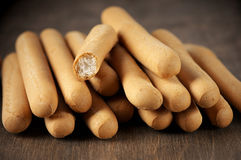 Breadsticks. Stack on wooden background royalty free stock image