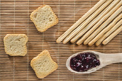 Breadsticks, toasts and blueberry jam Stock Image