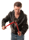 Break-In. Tough criminal in leather jacket with heavy-duty cutters Stock Photography