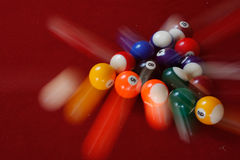 The Break. An image of a break in pool / billiards, using motion blur to show the 'break stock photo