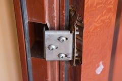 Break away mounting loops on cheap metal doors Stock Image