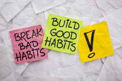 Break bad, build good habits. Break bad habits, build good habits - motivational reminder on colorful sticky notes - self-development concept stock photo