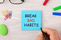 Break Bad Habits. Handwriting on note with marker pen and various stationery. Business concept royalty free stock images