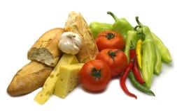 Break baguette and fresh vegetables Stock Photo