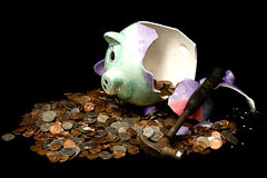 Break the Bank. Concept Breaking the Bank with piggy bank broke with coins surrounding it Stock Image