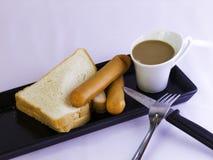 Break. Fast sausage, toast, coffee Stock Photos