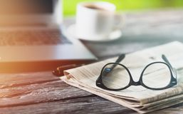 Break. Broadsheet business coffee communication computer daily Royalty Free Stock Images