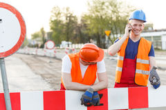 Break for a call. Construction workers have a break for a call Stock Image