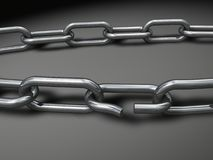 Break the Chains. A broken chain representing freedom or insecurity Royalty Free Stock Photography